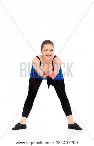 Beautiful young woman dancer, isolated on white background