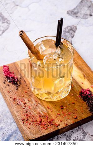 Close Up, Bright Orange Brown Alcoholic Cocktail With Whiskey, Ice Cubes Decorations On A Wooden Boa