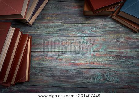 A Lot Of Books On A Colored Wooden Background With Copy Space.