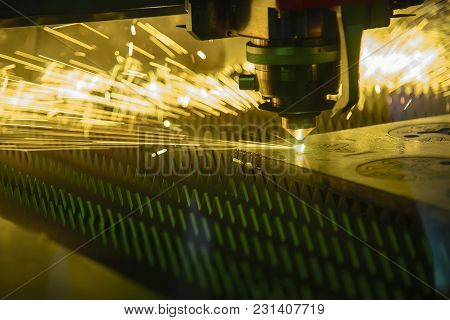 The Fiber Laser Cutting Machine Cutting The Metal Sheet Plate.