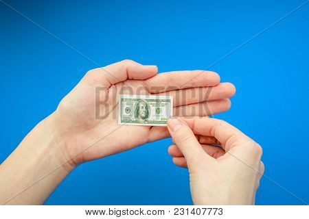 3414811 Woman's Hand Holding Small Banknote Of 100 Us Dollar