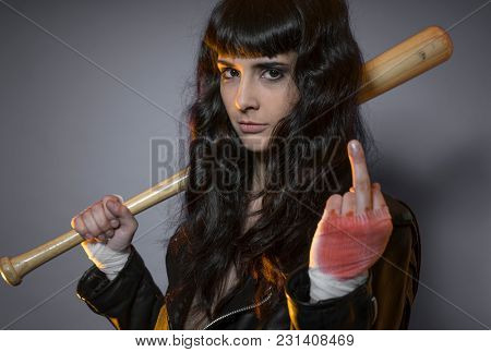 Trouble, adolescence and delinquency, brunette woman in leather jacket and baseball bat with challenging aptitude