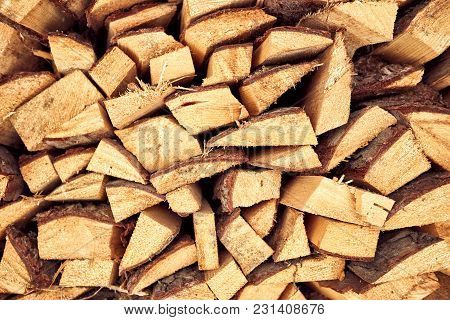 Firewood For Heating The House In Winter For A Fireplace And A Stove.