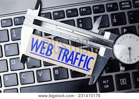 Web Analytics Concept, With Caliper On Laptop Keyboard Measuring Online Website Traffic Web Analytic