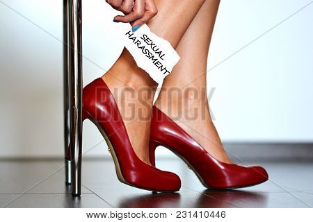 Sexual Harassment Alert With Young Woman With Red High Heels Shoes Showing A Note With The Text