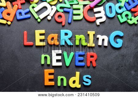 Learning Never Ends Words Written On Chalkboard With Colorful Plastic Letters