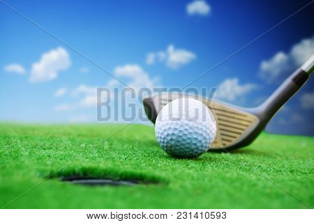 Golfer Prepared For A Golf Shut In Green Grass In A Sunny Day With Clear Blue Sky