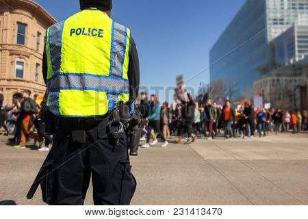 Police standing by to protect teens peacfully marching  in prote