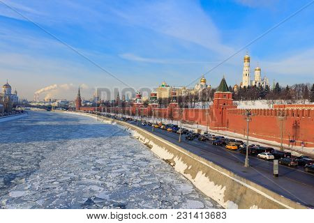 Frozen Moskva River On The Background Of Kremlevskaya Embankment On A Sunny Winter Morning