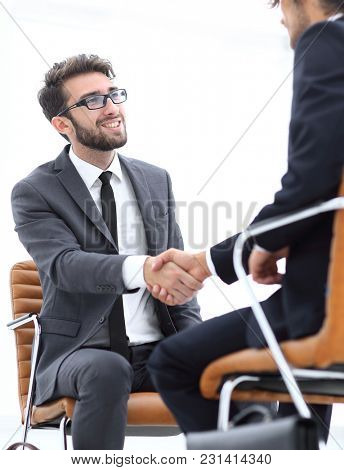 wo focused coworkers sitting together in a modern office