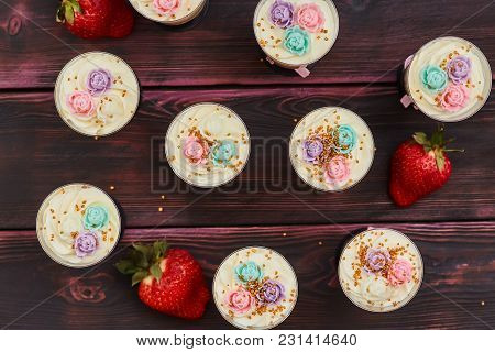 Cake With Strawberry Served In Glass Shots, Wooden Background