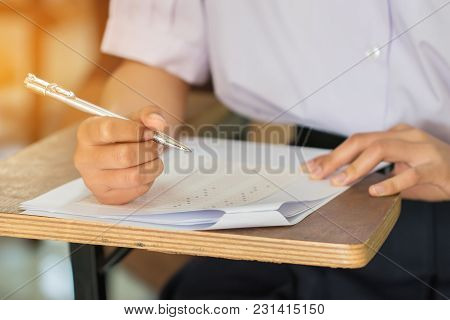Education Test Concept : Hands Asian Students Thai Uniform Holding Pen For Testing Exams Writing Ans