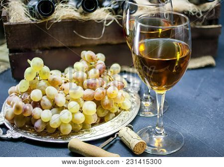 White Dry Wine. Glass Of Wine On A Dark Background. Alcoholic Beverages Background. House Wine-makin