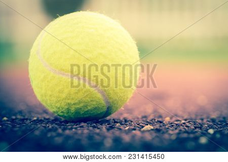 Sport Item Concept : Tennis Balls At Red Court In Summer Day. Tennis Is Racket Sport That Can Be Pla