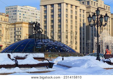 Moscow, Russia - February 14, 2018: Snow-covered Manege Square And World Clock Fountain On The Backg
