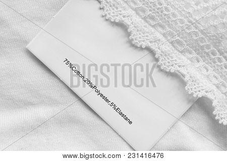 Fabric Composition Clothes Label On White Textile Background Closeup