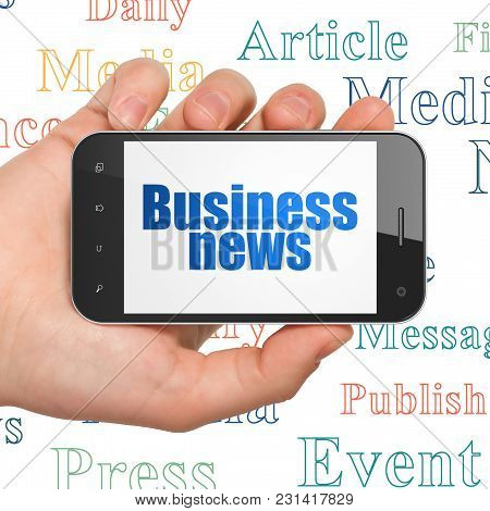 News Concept: Hand Holding Smartphone With  Blue Text Business News On Display,  Tag Cloud Backgroun