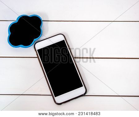 Mobile Phone On White Chair Background With Small Board Cloudt , Black Space For Insert Text Or Imag