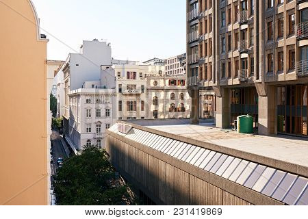 Modern And Historical Buildings On A Street In The Commercial District Of A City On A Sunny Day