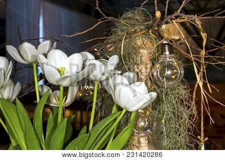 White Tulips Near Lamps Hanging On A Branch, Wooden Pillar Decoration