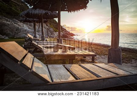 Beautiful Sunset Sky And Wood Desk On Sea Beach