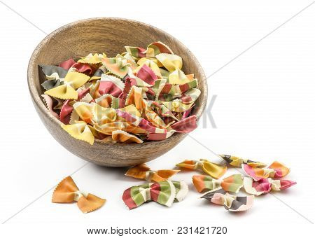 Farfalle Pasta With Vegetables In And Near A Wooden Bowl Isolated On White Background Raw Classic Tr
