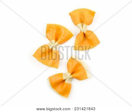 Farfalle Pasta With Orange Carrot Isolated On White Background Top View Three Raw Classic Traditiona
