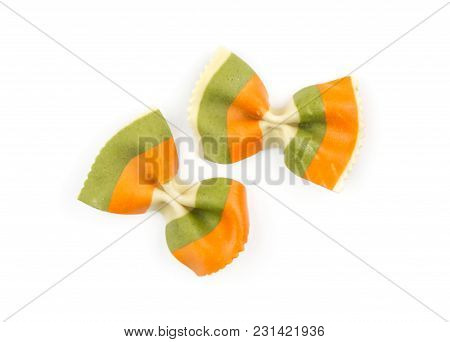 Farfalle Pasta With Green Spinach And Orange Carrot Isolated On White Background Top View Two Raw Cl