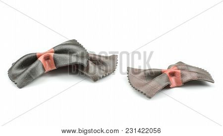 Farfalle Pasta With Black Cuttlefish Ink Isolated On White Background Three Raw Pieces Classic Tradi