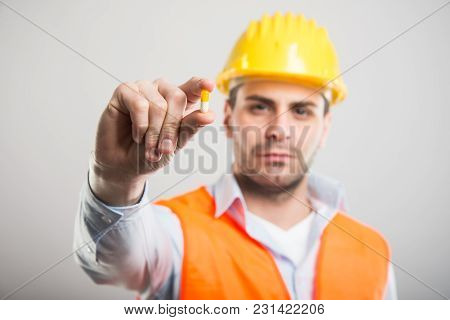 Selective Focus Of Handsome Architect Holding One Pill