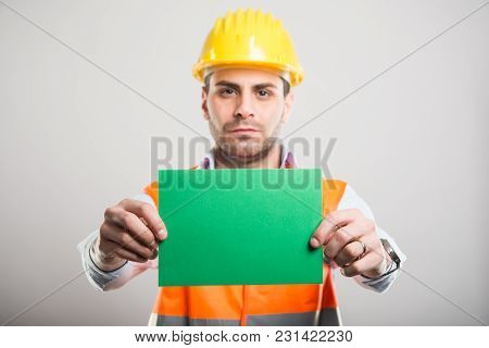 Selective Focus Of Handsome Architect Holding Green Cardboard