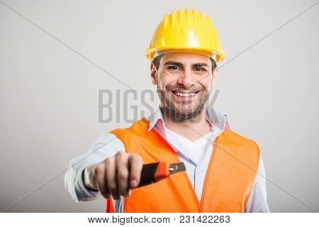 Portrait Of Handsome Architect Holding Cutter Tool
