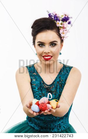 Easter Eggs In Hands And Blurred Woman On Background
