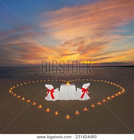 Romantic Dinner With Candles Heart, Luxury Decorated Table And Wine At Ocean Tropical Sandy Beach Du