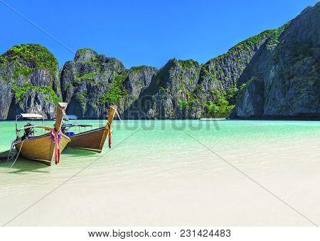 Famous Scenic Maya Bay Beach At Ko Phi Phi Leh Island With Two Traditional Longtail Taxi Boats Moori