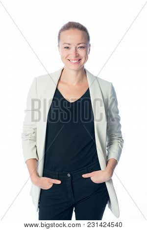 Full Body Portrait Of Casualy Dressed, Cheerful, Beautiful, Smart, Young Businesswoman In Standing A