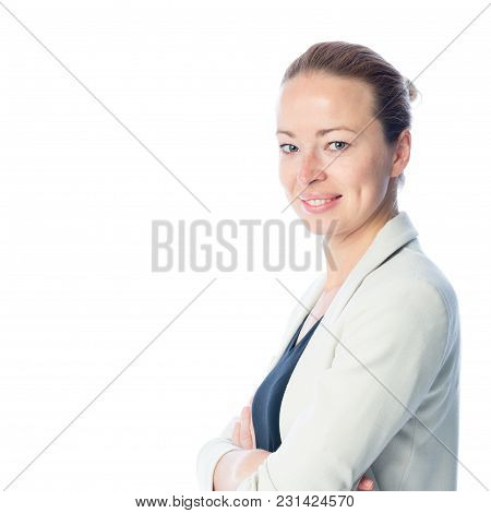 Side Portrait Of Casualy Dressed, Cheerful, Beautiful, Smart, Young Businesswoman In Standing With A