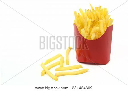 French Fries In A Red Carton Box In Close-up And Isolated On White Background With Copy Space Place.