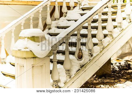 An Old Wooden White Staircase Covered With Snow. Winter Building View For Design, Web, Posters, Prin