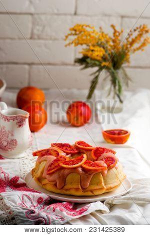 Blood Orange Pound Cake With An Orange Zest Icing..vintage Style.selective Focus