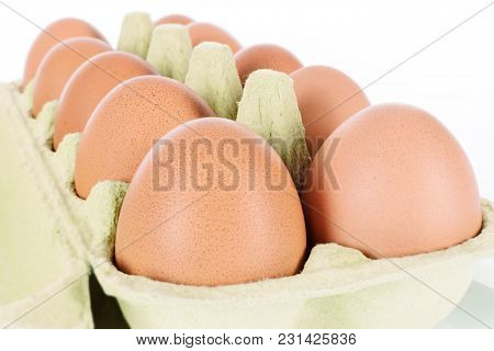 Ten Eggs In A Container In Close Up And Isolated On White Background