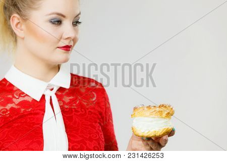 Sweet Food And Happiness Concept. Woman Holding Yummy Choux Puff Cake With Whipped Cream.
