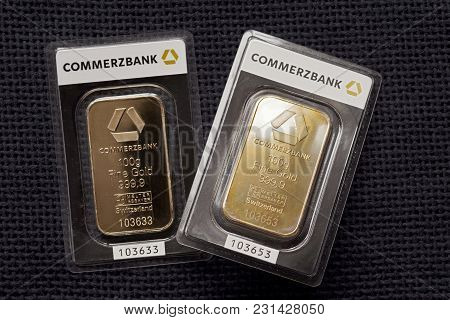 Kyiv, Ukraine - Circa 2017: Two Minted Gold Bars Weighing 100 Grams Each Against The Background Of A