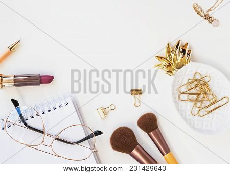 Beautiful Feminine Accessories In Gold Color On The White Table, Top View