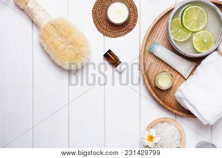 Spa Essentials On The White Wooden Background, Top View