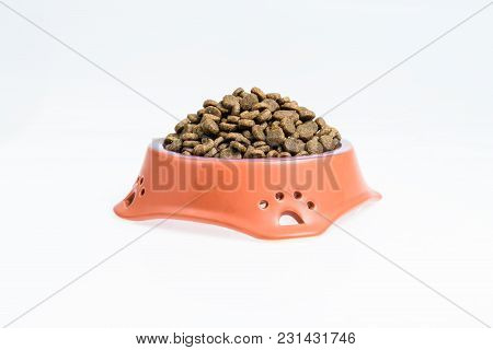 Ceramic Bowl With Dried Pet Food On White Background.