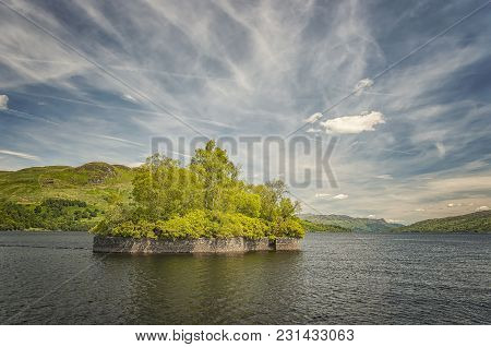 Fresh Water Loch In The Scottish Highlands, Loch Katrine. Pictured Is Factors Isle, Where Walter Sco