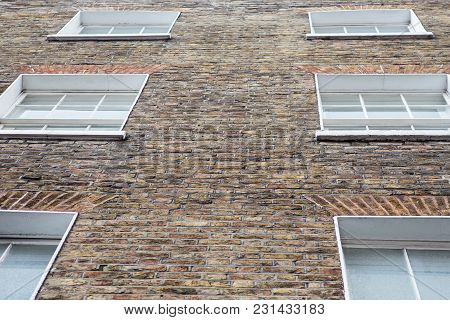 Windows And Brick Exterior Of A Georgian Style Property