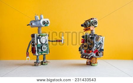 Robots On Yellow Background. 4th Industrial Revolution Automation Concept. Robotic Serviceman With S