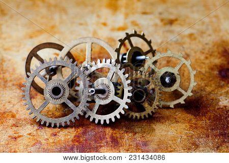 Antique Clock Mechanism Steampunk Style Cogs Gears Wheels Macro View. Vintage Rusty Metal Surface Ba